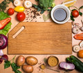 Cutting board, vegetables, herbs and spices. Colorful ingredient Royalty Free Stock Photo