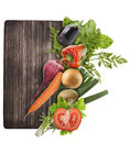 Cutting board and vegetables isolated on white background Stock Image