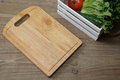 Cutting board on a wooden background Royalty Free Stock Photo