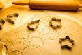 Cutting christmas cookies made ​​of gingerbread and rolling pin Royalty Free Stock Image