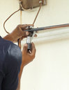 Cutting a copper pipe with a pipe cutter Royalty Free Stock Photo