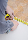 Cutting gypsum plasterboard male hands measuring and Stock Photo