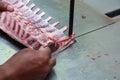 Cutting lamb rack or chop Royalty Free Stock Photo