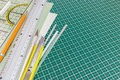 Cutting mat with utility knife, mechanical pencil, metal ruler a Royalty Free Stock Photo