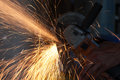 Cutting metal with grinder man lots of sparks Royalty Free Stock Photo