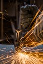 Cutting metal worker with grinder Royalty Free Stock Photography