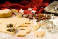 Cutting out Christmas cookies Royalty Free Stock Images