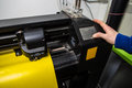 Cutting plotter in the factory Royalty Free Stock Photo