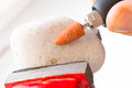 Cutting and polishing stone with rotary multi tool using a high speed to on the Stock Photos