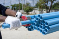 Cutting PVC pipe Royalty Free Stock Image