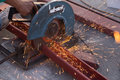Cutting steel channel steel c chanel with grinder sparks while grinding iron Royalty Free Stock Image