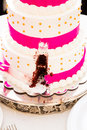 Cutting the wedding cake a has a missing slice after bride and groom cut at their reception Stock Images
