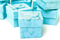 Cyan gift boxes closeup on white background Royalty Free Stock Photo