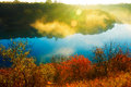 The cyan lake and golden sunshine and autumn trees Royalty Free Stock Photo