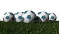 Cyan soccer balls on a green grass Stock Photography