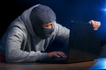 Cyber crime criminal hacking into a computer fear of getting caught Royalty Free Stock Image