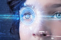 Cyber girl with technolgy eye looking into blue iris modern Stock Photography