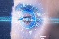 Cyber man with technolgy eye looking into blue iris modern Royalty Free Stock Photos