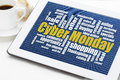 Cyber monday shopping word cloud on a digital tablet with a cup of coffee a holiday online concept Royalty Free Stock Photo
