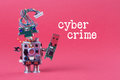 Cybercrime and data hacking concept. Retro robot with usb flash storage stick, stylish computer character blue eyed head Royalty Free Stock Photo