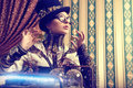 Cyberpunk portrait of a beautiful steampunk woman over vintage background Royalty Free Stock Photo