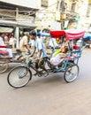 Cycle rickshaw transports passenger in delhi india oct rider early morning on october rickshaws were introduced Royalty Free Stock Image