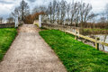 Cycleway footpath over bridge and an old stone Royalty Free Stock Image