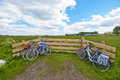 Cycling in the countryside bicycles near wooden fence peaceful landscape Stock Image