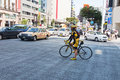 Cycling in the district of Ginza, Japan Royalty Free Stock Photo