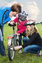 Cycling family a in front of rural landscape Stock Image
