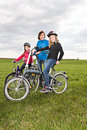 Cycling family a in front of rural landscape Royalty Free Stock Photos