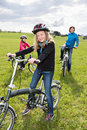 Cycling family a in front of rural landscape Royalty Free Stock Photography