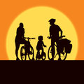 Cycling family parents and child on a summer trip Stock Photos