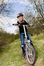 Cycling girl a in front of rural landscape Stock Photo