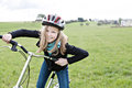Cycling girl a in front of rural landscape Stock Images