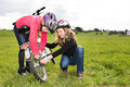 Cycling girls a in front of rural landscape Royalty Free Stock Photos
