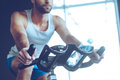 Cycling at gym. Royalty Free Stock Photo