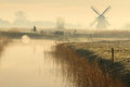 Cycling in holland cyclist and a foggy spring sunrise the dutch countryside Royalty Free Stock Image