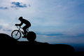 Cycling on mountain hill before dark Royalty Free Stock Images