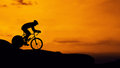 Cycling on mountain hill twilight time Royalty Free Stock Photography