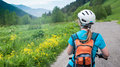 Cycling in mountains a woman Royalty Free Stock Images
