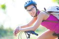 Cycling portrait of young sporty woman with bicycle outdoor Royalty Free Stock Photography