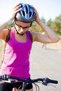 Cycling portrait of young sporty woman with bicycle outdoor Royalty Free Stock Photos