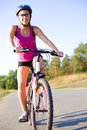 Cycling portrait of young sporty woman with bicycle outdoor Stock Photography