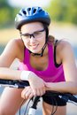 Cycling portrait of young sporty woman with bicycle outdoor Stock Photo