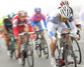 Cycling race participants of a motion blur Royalty Free Stock Photography