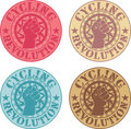 Cycling revolution badges with a fist in a bike chainring Royalty Free Stock Photo