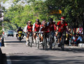 Cycling sports group crossed the street anjuk ladang nganjuk east java on Stock Photography