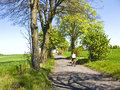 Cycling in spring rural dirt path Royalty Free Stock Photo