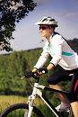Cycling woman a in front of rural landscape Stock Images